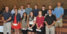 Fourteen students from Fort Atkinson High School were awarded a $1,000 Ed Karrels AP Computer Science Scholarship at the August 2015 School Board meeting.  They are, pictured above left to right: Front row - Computer Science teacher Aaron Chamberlain, recipients Megan Charland, Evalise Yang, Mikaela Stelse, and Anna Compas, and math teacher Dean Johnson.  Back row - Scholarship benefactor Ed Karrels, recipients Zavery Dickson, Kyle Harker, Alex Johnson, Brett Koenig, Jonah Cartwright, and Harry Bos.  Not pictured are Tyler Ault, Alec Redenbaugh, Nikolai Vechinsky, and Mary Wilson. - Photo by Daily Union reporter Randall Dullum.