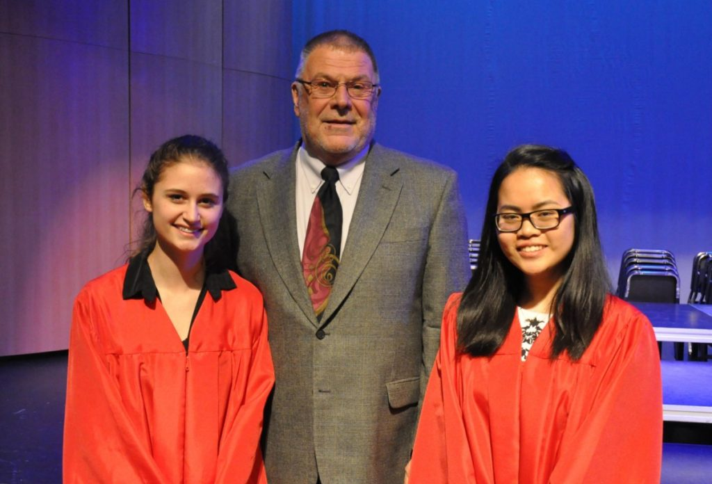 In May 2016, Fort Atkinson High School graduating seniors Christina Smithyman (left) and Thanh Phuong Nguyen (right) were presented with $22,000 Walter and Louise Buell Merit Scholarships by Fort Atkinson Community Foundation chairman Dean Brown.